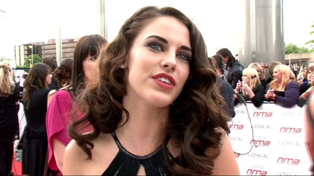 National Movie Awards 2011 red carpet arrivals Jessica Lowndes interview SOT On dream film role something challenging and romcom Action star name not...