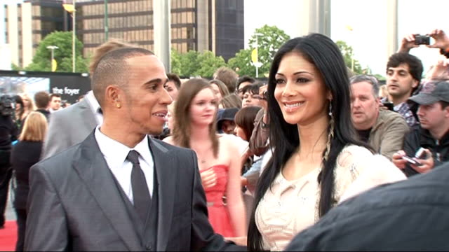 national movie awards 2011 red carpet arrivals lewis hamilton and nicole scherzinger posing together lewis hamilton and nicole scherzinger interview... - nicole scherzinger stock videos and b-roll footage