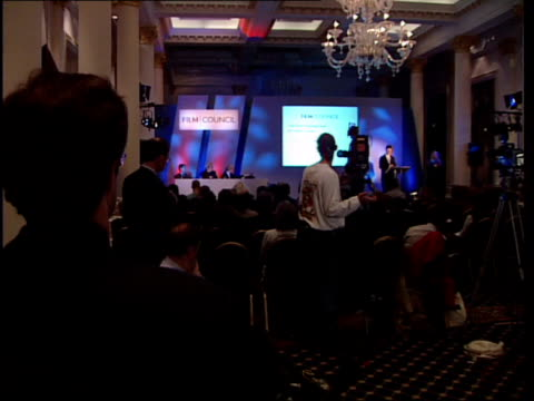 new film council set up itn england london int backdrop to press conference at launch of new film council tilt down head of film council alan parker... - handful stock videos & royalty-free footage