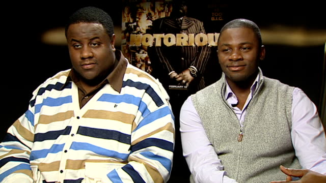 notorious big biopic cast interviews jamal woolard and derek luke interview sot on how well the film did in the us / have they partied with p diddy /... - biggie smalls stock videos and b-roll footage
