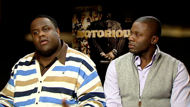 notorious big biopic england london int jamal woolard interview sitting alongside derek luke sot on his name big his ambition big appetite for... - biggie smalls stock videos and b-roll footage