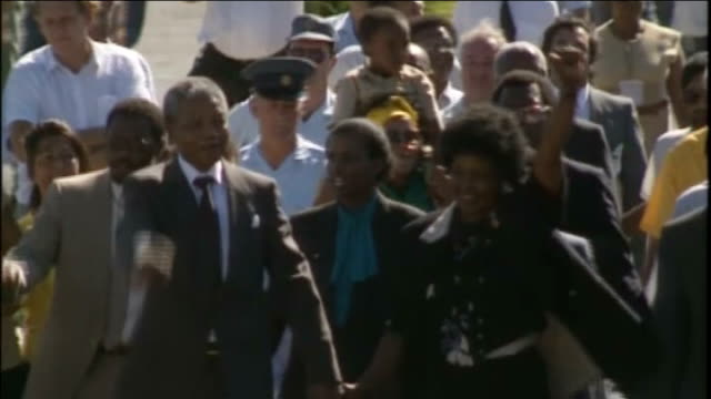 Film of Nelson Mandela's life premieres in South Africa R11029001 / TX Cape Town Victor Verster Prison EXT Nelson Mandela and Winnie Mandela raising...