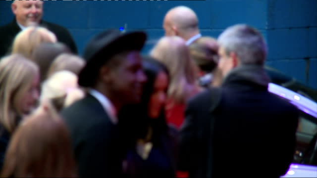 'Olympus Has Fallen' premiere Red carpet arrivals Unidentified men posing / Alex Arnold and unidentified woman posing / Kelly Adams posing / obscured...