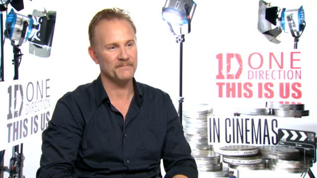 'one direction this is us' morgan spurlock interview england london int morgan spurlock interview sot discuss the new documentary film band one... - ドキュメンタリー映画点の映像素材/bロール