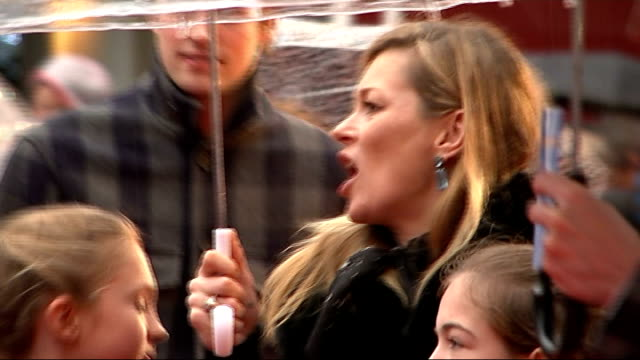 'paddington' world film premiere; england: london: leicester square: ext / rain hugh bonneville signing autographs kate moss along with umbrella jim... - ben whishaw stock videos & royalty-free footage