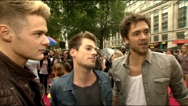 'part of me' film premiere lawson interview sot / katy perry as interviewed by tv crew / perry's jimmy choo shoes as along at premiere / misha b on... - jimmy perry stock videos and b-roll footage