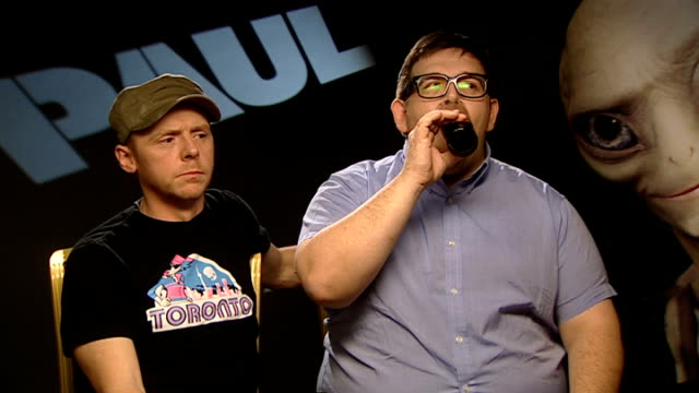 interviews; england: int simon pegg and nick frost interview sot - discuss new science fiction film, 'paul' - science fiction film stock videos & royalty-free footage