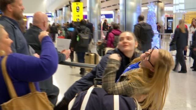 people recreating famous 'love actually' scene at heathrow airport at christmas; england: london: heathrow airport: int family laughing family... - family stock videos & royalty-free footage