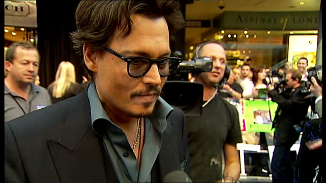 'Pirates of the Caribbean On Stranger Tides' premiere red carpet arrivals Depp greeting Beatrice Delap on red carpet / Johnny Depp interview SOT On...