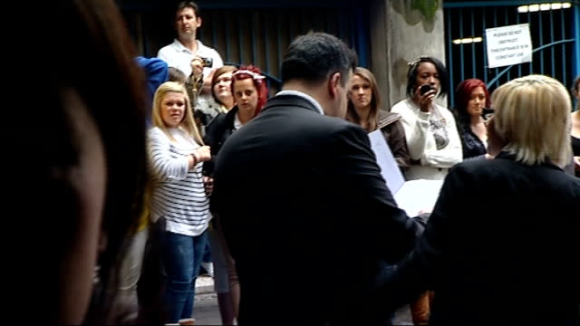 'jls' film premiere ext jls fans on street jls interview as along in limousine sot ext jls fans cheering as line up on street - limousine stock-videos und b-roll-filmmaterial