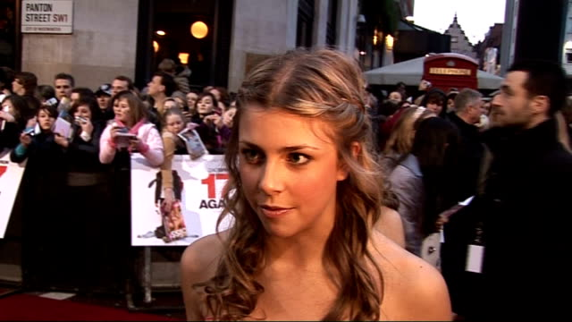 film premiere of '17 again': screaming fans / celebrity arrivals and interviews; jemma mckenzie-brown along on red carpet and speaking to press /... - general certificate of secondary education stock videos & royalty-free footage