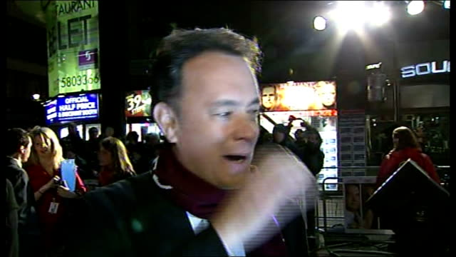 Film premiere of 'Charlie Wilson's War Tom Hanks interview ENGLAND London Leicester Square Reporter to camera at film premiere of Charlie Wilson's...