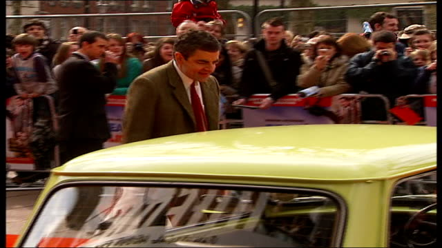 premiere of 'mr bean's holiday' **rowan atkinson interview overlaid sot** atkinson along on red carpet and standing on bonnet of yellow mini car - ローワン アトキンソン点の映像素材/bロール