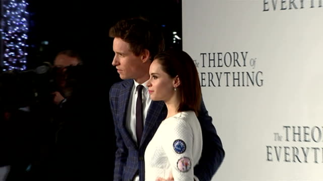 premiere of 'the theory of everything' stephen hawking biopic *** warning redmayne and actress felicity jones posing for photocall - 伝記映画点の映像素材/bロール