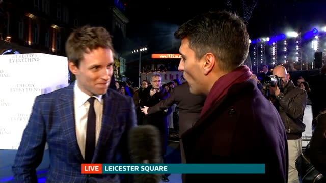 premiere of 'the theory of everything' stephen hawking biopic england london leicester square reporter to camera eddie redmayne live interview sot - 伝記映画点の映像素材/bロール