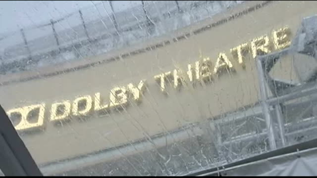 Preview of Academy Awards 2014 USA California Los Angeles Water being mopped away on Hollywood Walk of Fame View of Dolby Theatre Low angle view of...