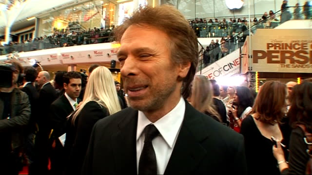 Prince of Persia Sands of Time premiere Red carpet arrivals and interviews Jerry Bruckheimer interveiw SOT On releasing the first blockbuster of the...