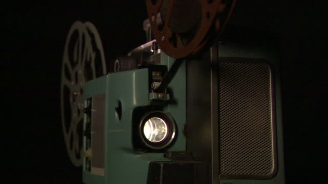cu film projector projecting a reel of film/ los angeles, california - film projector stock videos & royalty-free footage