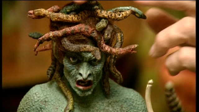 ray harryhausen exhibition at the london film museum; england: int model of medusa used in film 'clash of the titan's being moved by animator ray... - titan moon stock videos & royalty-free footage