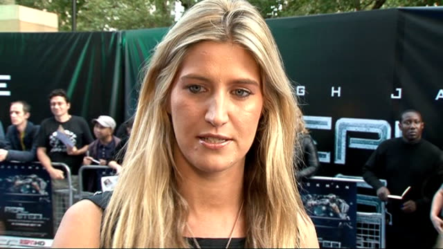 'real steel' film premiere in london cheska hull interview sot on hugh jackman / on the new series nervous / on locations abroad that she wants to go... - chloe designer label stock videos and b-roll footage