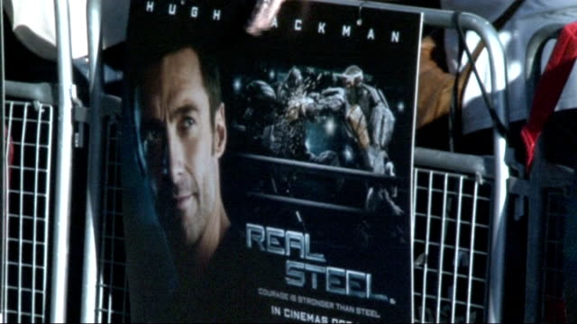'real steel' film premiere in london; england: london: ext various general views of film poster and robot / various general views of titan the robot... - titan moon stock videos & royalty-free footage
