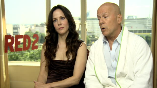 'red 2' junket interviews england london int marylouise parker and bruce willis interview sot - bruce willis stock videos and b-roll footage
