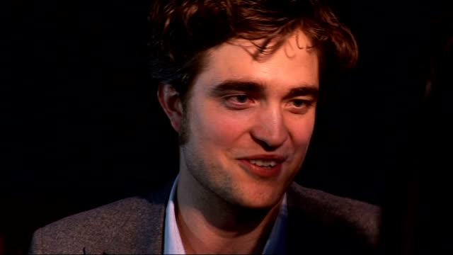 'Remember Me' premiere red carpet arrivals Tom Felton speaking to press / Robert Pattinson speaking to press / Robert Pattinson interview SOT On...