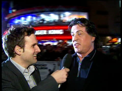 vídeos de stock e filmes b-roll de 'rocky balboa' sylvester stallone interview **beware england london leicester square ext sylvester stallone live interview on red carpet with... - live and let live film title