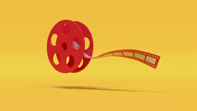 vídeos y material grabado en eventos de stock de rollo de película rojo amarillo estilo de dibujos animados mínimo 3d renderización de cine concepto - largometrajes
