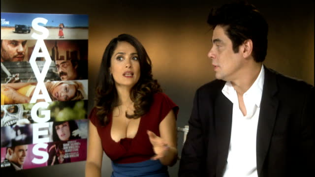 vídeos de stock, filmes e b-roll de 'savages' released salma hayek alongside benicio del toro interview sot - salma hayek
