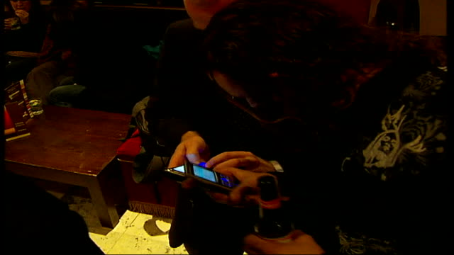 'scenes of a sexual nature' speeddating world record attempt at launch people using mobile phones - world record stock videos & royalty-free footage