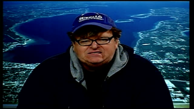 'sicko' interview with michael moore england london gir int michael moore live 2way interview from michigan sot i was trying to enlighten the public... - repetition stock videos and b-roll footage
