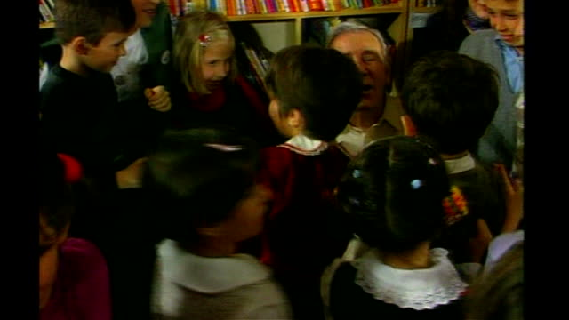 sir norman wisdom dies 2001 albania tirana int orphan children in library mobbing norman wisdom during the comedian's visit to the country wisdom... - tirana stock videos and b-roll footage