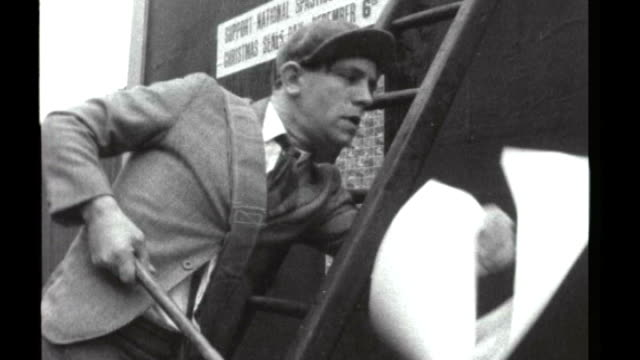 sir norman wisdom dies 7121955 london w footage of norman wisdom launching spastic society's christmas seal's day by indulging in slapstick comedy... - slapstick stock videos & royalty-free footage
