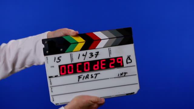 film slate on chroma key blue background - slate rock stock videos and b-roll footage