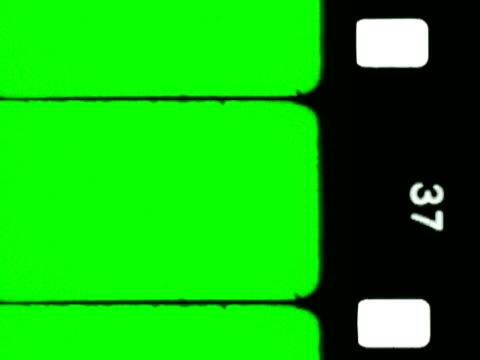 stockvideo's en b-roll-footage met film sprocket holes with chroma key and audio. ntsc/ pal - sprocket