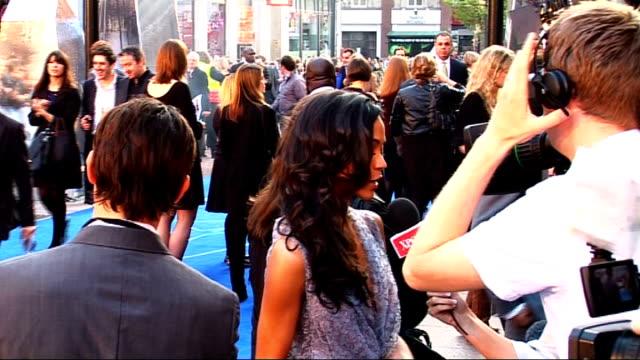 Star Trek film premiere Zoe Saldana talking to press on red carept/ Jeremy Clarkson talking to unidentified man on red carpet/ Zoe Saldana talking to...