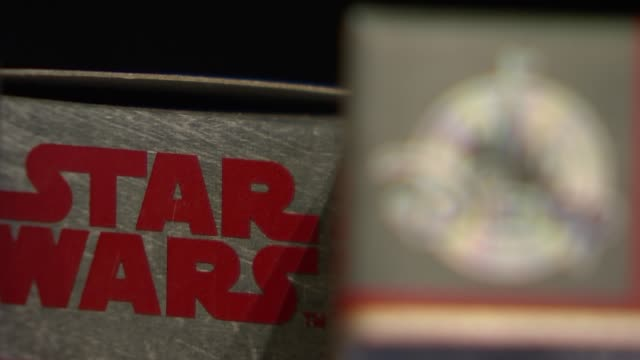 staw wars merchandise in disney store england london int various of goods being sold in disney store including star wars merchandise / shoppers in... - star wars stock videos & royalty-free footage
