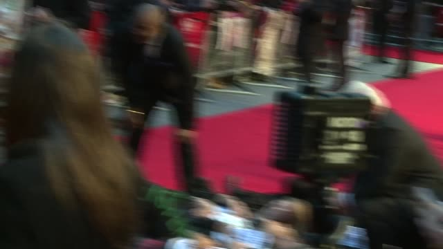'suffragette' film premiere demonstrators lying on red carpet and chanting 'dead women can't vote' sot / 'the struggle is not over' banner / romola... - romola garai stock videos & royalty-free footage