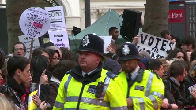 'suffragette' film premiere england london bfi london film festival sign / 'suffragette' film poster / fans and protesters with placards '5050... - romola garai stock videos & royalty-free footage