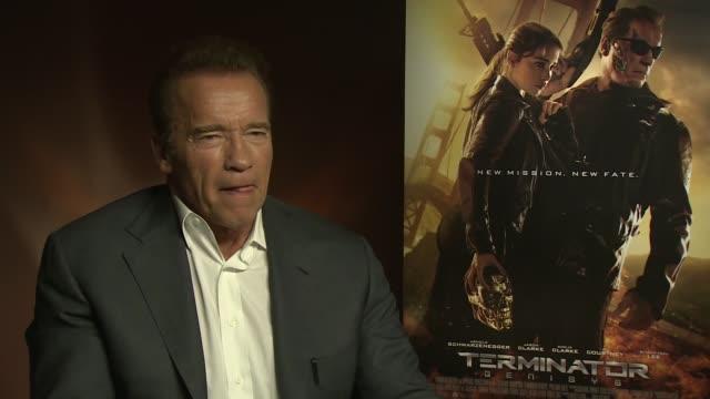 'terminator genisys': junket interviews; england: london: int arnold schwarzenegger interview sot - terminator stock videos & royalty-free footage