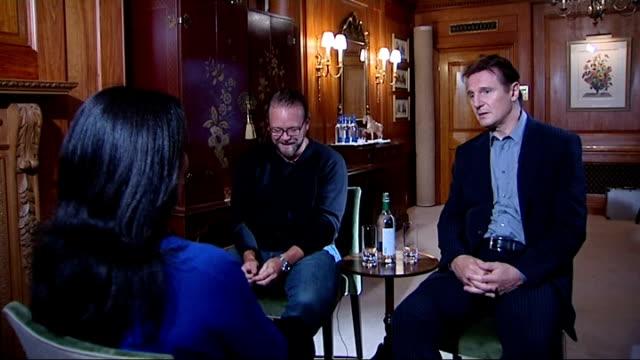 liam neeson and joe carnahan interview; england: london: int liam neeson and joe carnahan arriving and meeting nina nannar / liam neeson and joe... - chemistry点の映像素材/bロール