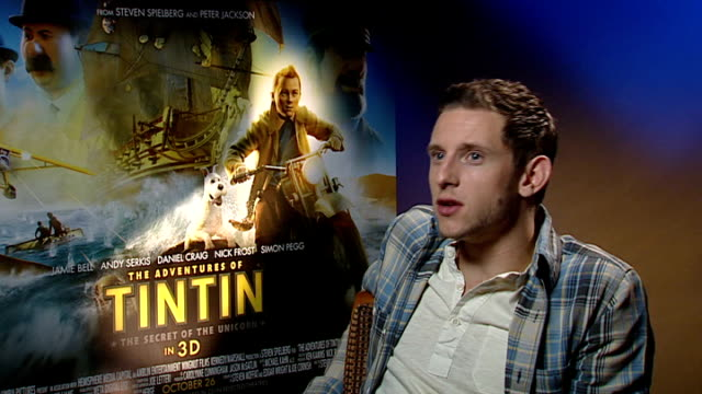 'the adventures of tintin' released junket interviews england london int jamie bell interview sot praises interviewer's tshirt / on being new indiana... - new age stock videos & royalty-free footage