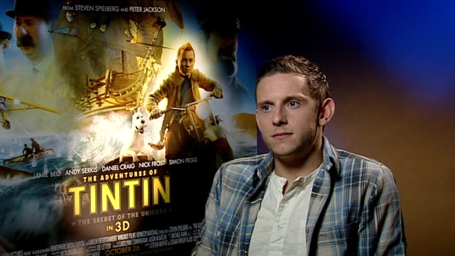 'the adventures of tintin' released: junket interviews; jamie bell interview sot - if tintin had been at news of the world there wouldn't have been... - an answer film title stock videos & royalty-free footage