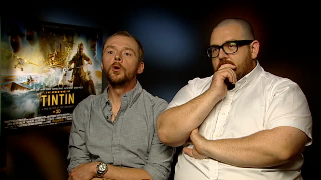 'the adventures of tintin' released junket interviews simon pegg and nick frost interview sot if tintin had been at news of the world there wouldn't... - an answer film title stock videos & royalty-free footage