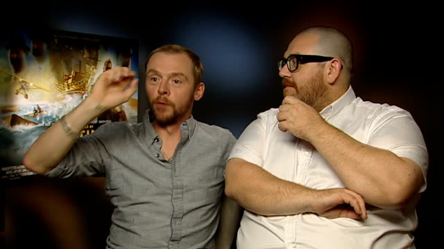 'the adventures of tintin' released junket interviews simon pegg and nick frost interview sot saw it screened at cinema amazing to see their names at... - nick frost actor stock videos & royalty-free footage