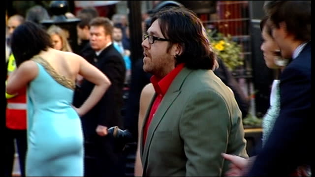 'the boat that rocked' premiere arrivals nick frost posing with girls dressed in 1960s dresses and nick frost along red carpet / frost along to be... - nick frost actor stock videos & royalty-free footage