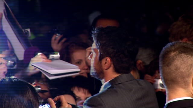 'The Bounty Hunter' premiere Gerard Butler with fans signing autographs Jennifer Aniston arrival Andy Tennant interview to other crew SOT explains...