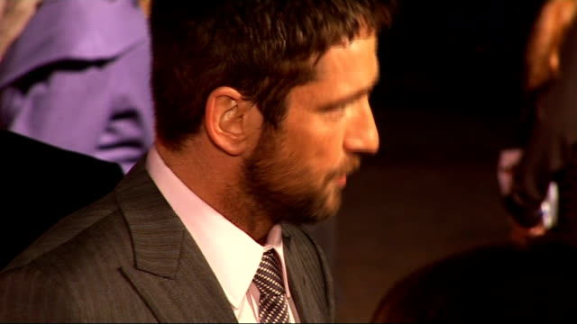 'The Bounty Hunter' premiere GV's of Gerard Butler and Jennifer Aniston on stage below video screen Various shots of Butler talking to fans having...