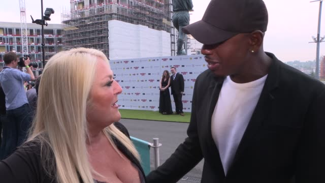 stockvideo's en b-roll-footage met 'the bromley boys' premiere: red carpet interviews; england: london: wembley: wembley stadium: ext vanessa feltz and ben ofoedue interview sot adam... - vanessa feltz